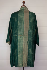 Neeru Kumar long kimono jacket in shibori dyed silk, green with latte highlights, cotton lining, lightly quilted (rear view).