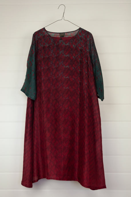 Neeru Kumar silk shibori dyed A-line tunic dress in deep cherry red with contrast in blue green / olive.