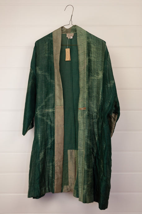 Neeru Kumar long kimono jacket in shibori dyed silk, green with latte highlights, cotton lining, lightly quilted.