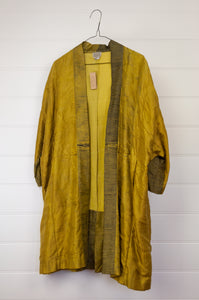 Neeru Kumar long kimono jacket in shibori dyed silk, gold with charcoal highlights, cotton lining, lightly quilted.