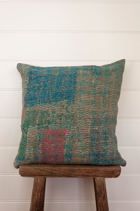 Vintage kantha cushion in deep aqua, teal and rose pink.