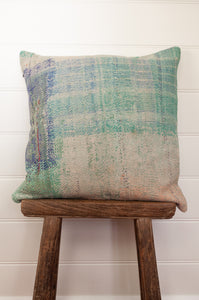 Vintage kantha cushion in soft mint and apricot, with blue highlights.