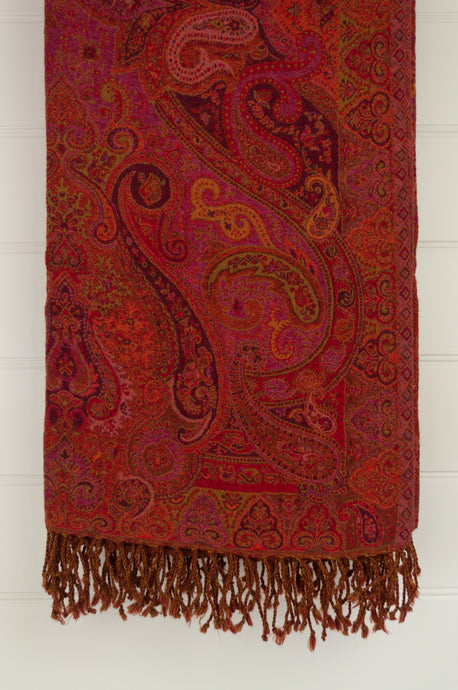 Juniper Hearth pure wool reversible tasseled throw rug with classic paisley design in vibrant rose pink, orange, burgundy and olive highlights.