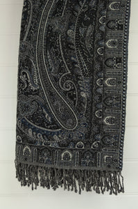 Juniper Hearth pure wool reversible tasseled throw rug with classic paisley design in charcoal, indigo and light grey.