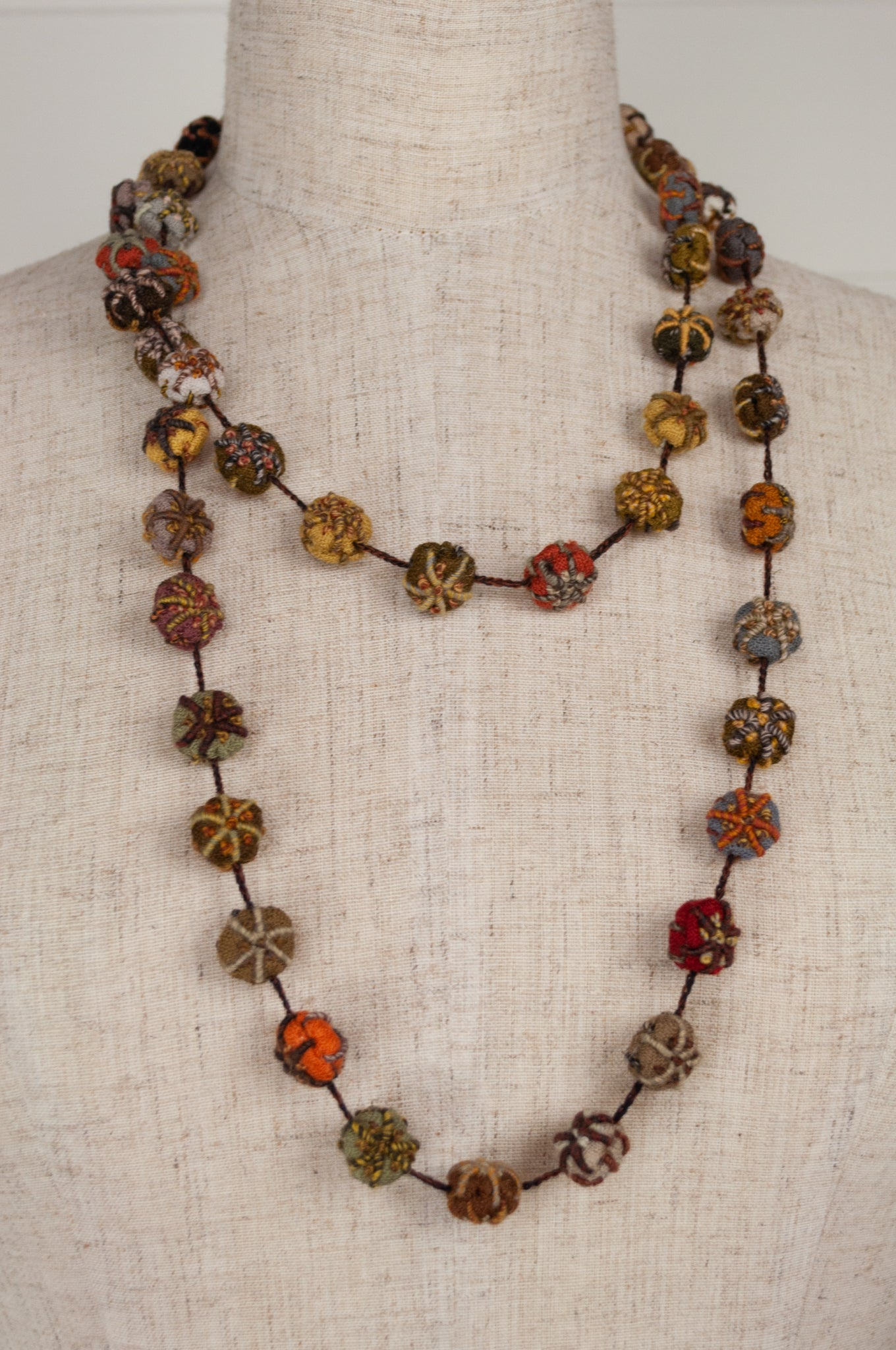 Sophie Digard Prairie long crocheted and embroidered necklace in wool and cotton in the Earth palette.