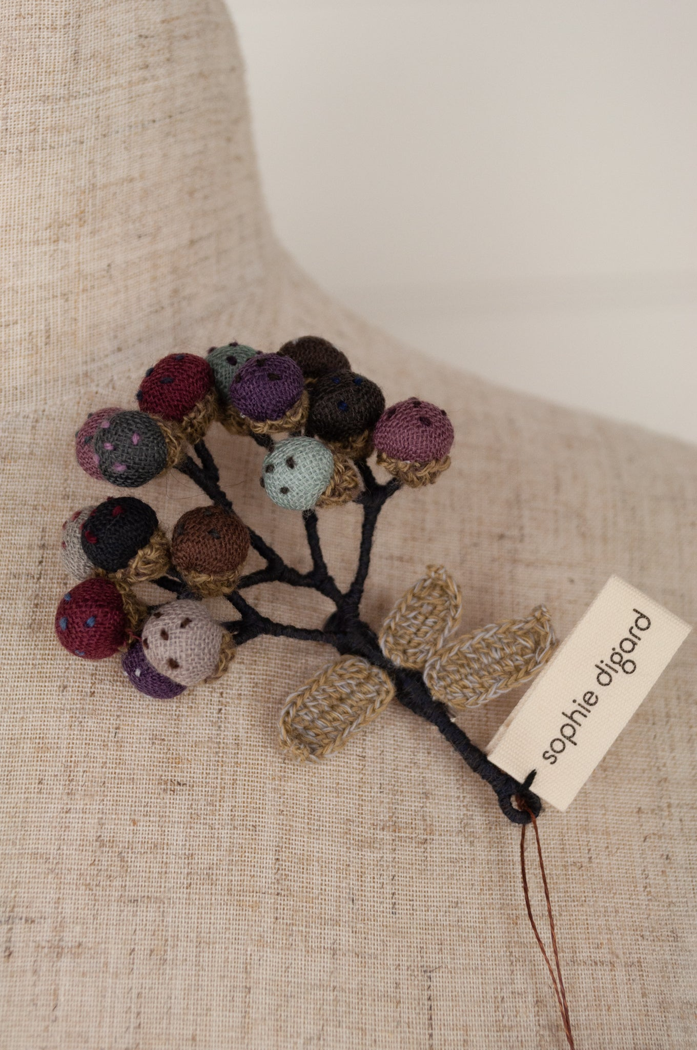 Sophie Digard Bulbs brooch, embroidered linen and wool in a muted winter palette of navy, grey, purple, burgundy, aqua and taupe.