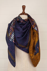 Inouistoosh square 130x130 silk and modal Andrew scarf in navy with saffron , lilac and light blue highlights.
