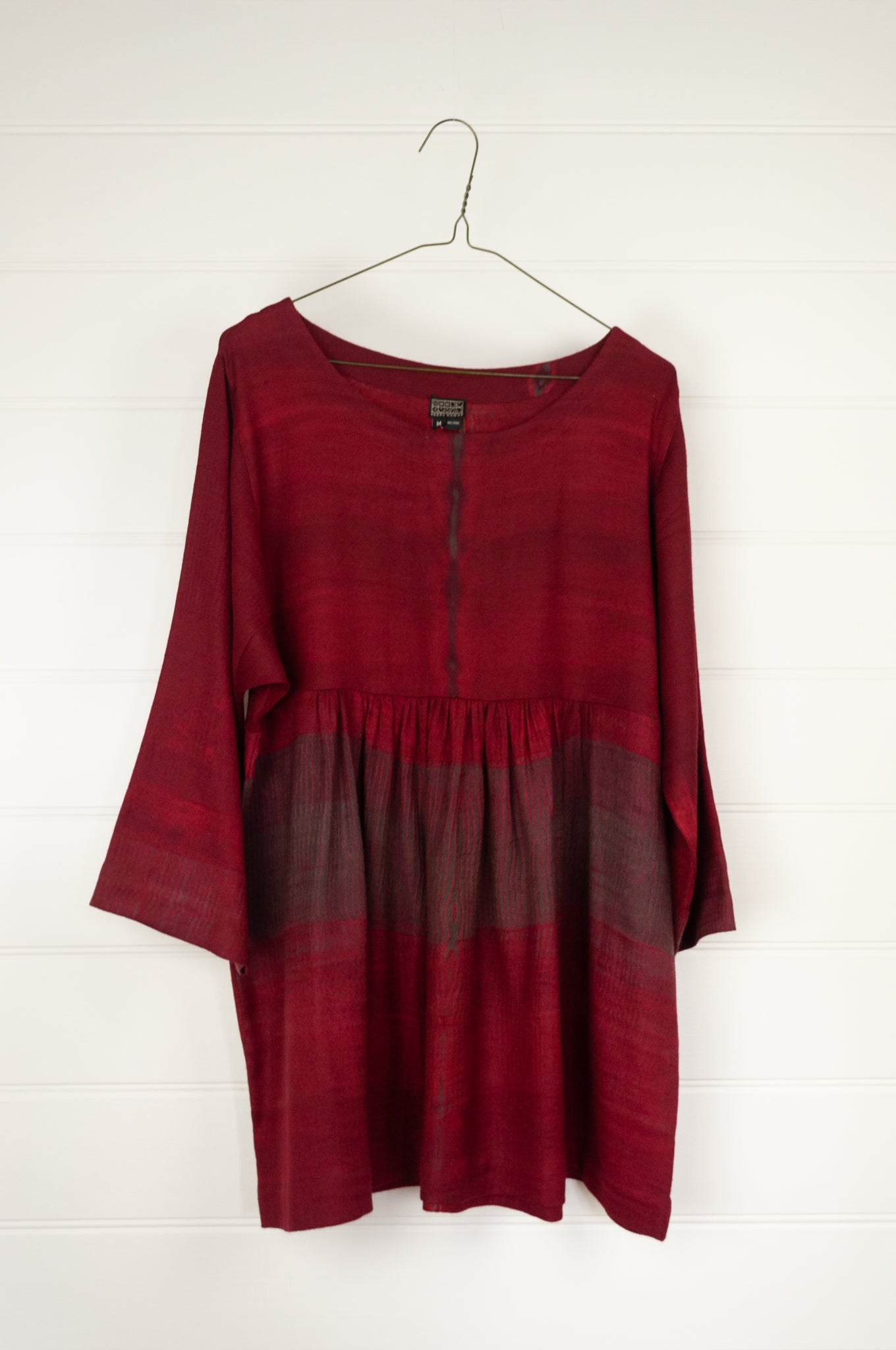 Neeru Kumar Cara wool shibori dyed peplum top in deep crimson.