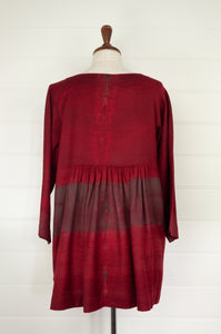 Neeru Kumar Cara wool shibori dyed peplum top in deep crimson (rear view).
