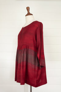 Neeru Kumar Cara wool shibori dyed peplum top in deep crimson (side view).