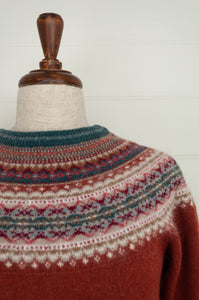 Eribé Alpine fairisle sweater in merino with angora,  Russet features a rich red brown body, with highlights of burgundy, teal, light grey and toffee.