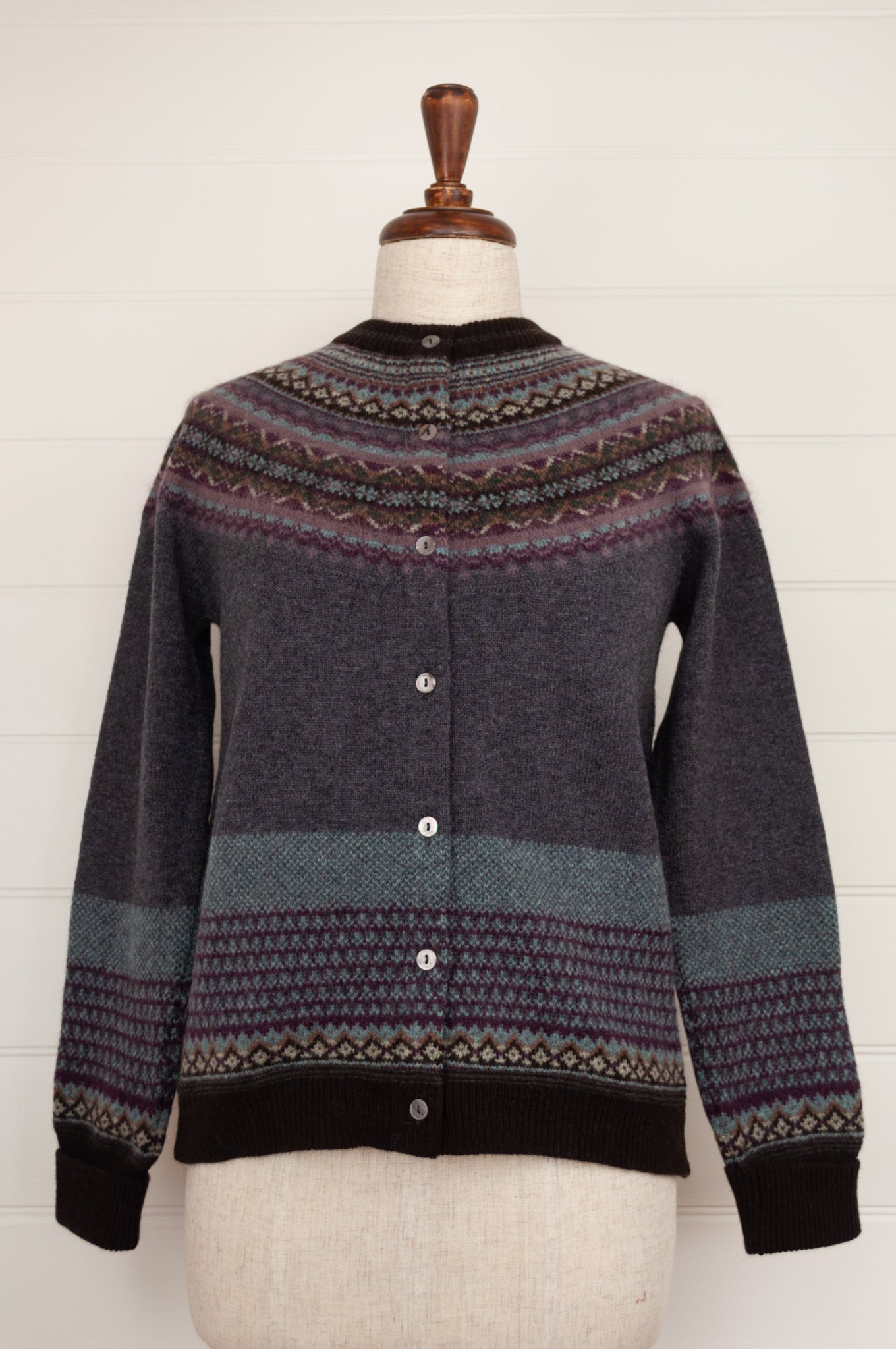 Eribé Selkie fairisle cardigan, merino wool with angora, in deep blue grey with purple, sky blue, ecru, toffee and chocolate brown highlights.