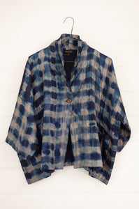 Raga indigo shibori silk kimono jacket, loose fitting with cropped sleeves and patch pockets.