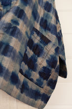 Load image into Gallery viewer, Raga indigo shibori silk kimono jacket, loose fitting with cropped sleeves and patch pockets (detail).