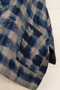 Raga indigo shibori silk kimono jacket, loose fitting with cropped sleeves and patch pockets (detail).