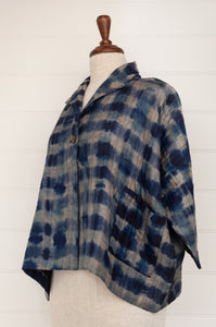 Raga indigo shibori silk kimono jacket, loose fitting with cropped sleeves and patch pockets (side view).