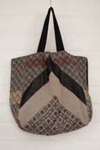 Load image into Gallery viewer, Létol market tote bag, reversible, made in France from organic cotton, featuring jungle print design in black and ecru, with highlights in red, and on the reverse a geometric print with bold chevron.