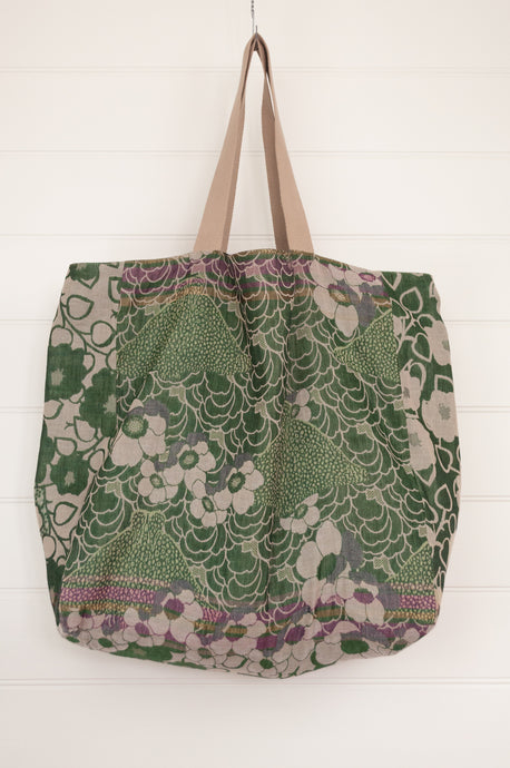 Letol market tote bag, made in France from organic cotton, fully reversible, featuring floral print in green and ecru with highlights in pink, leaf and geometric pattern in turquoise and teal on the reverse.