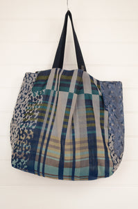 Letol market tote bag, made in France from organic cotton, fully reversible, featuring floral print in indigo blue and ecru with highlights in aqua, turquoise and teal stripe and animal print pattern on the reverse.