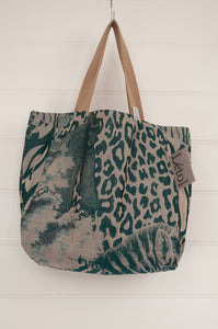 Létol French market tote reversible bag, animal print in teal and turquoise, leaf and floral print on reverse.