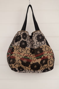 Létol French market tote reversible bag in black and white floral print with highlights in red, yellow and green.