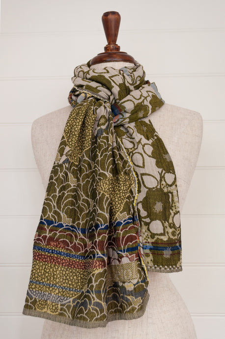 Létol organic cotton jacquard scarf made in France, Samantha orange gris, a field of flowers in shades of olive green and gold.