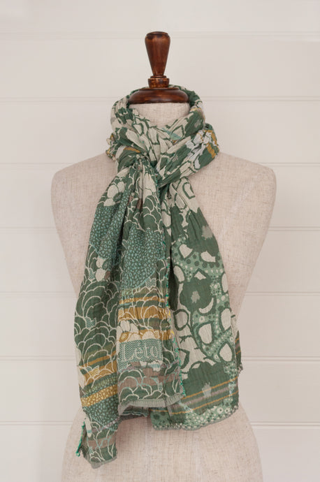 Létol organic cotton jacquard scarf made in France, Samantha orange gris, a field of flowers in shades of aqua blue, celadon green, with taupe and gold highlights.