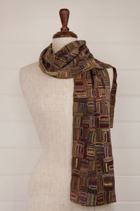 Sophie Digard Paris crochet wool scarf Air View, in rich earthy tones of brown and olive with pops of colour in gold, pink and red.