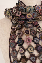 Load image into Gallery viewer, Sophie Digard Paris crochet scarf in merino wool, Magnolia, lace work flowers in relief in shades of navy, pink, taupe, teal and light blue on a coffee brown ground.