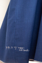 Load image into Gallery viewer, Dve Collection Anisha dress in pure handloomed khadi cotton in indigo, selvedge edge detailing, pintucked bodice front and back, one size three quarter sleeves (detail of hand embroidered motto).