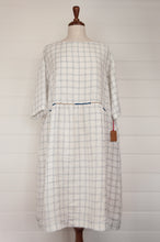 Load image into Gallery viewer, Dve Collection Padma dress in pure linen, ecru white with indigo windowpane check, selvedge edge detailing, hand embroidered at waist, one size three quarter sleeves.