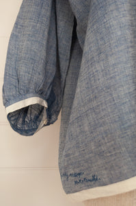 Dve Collection Anisha top in chambray khadi hand loomed cotton, pin tucked bodice front and back, three quarter sleeve, selvedge edge detail. One size (sleeve detail).