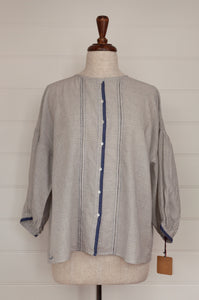 Dve Collection Ishi top in hand loomed khadi cotton ecru with indigo check, hand stitched faggoting and selvedge detailing, shell buttons, three quarter sleeves.