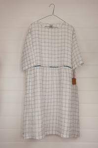 Dve Collection Padma dress in pure linen, ecru white with indigo windowpane check, selvedge edge detailing, hand embroidered at waist, one size three quarter sleeves.