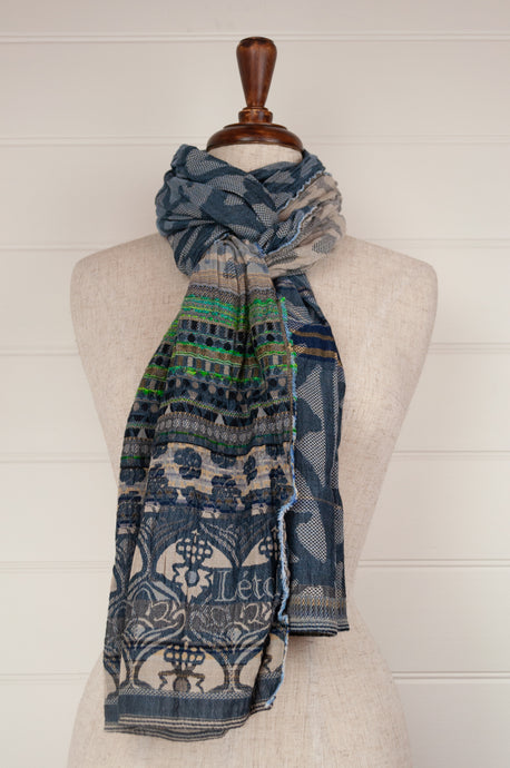 Létol organic cotton jacquard scarf, made in France,Vic is a classic Létol design of patterned stripes, celebrating denim blue, with a fabulous striped section in brilliant turquoise and emerald green.