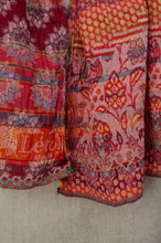 Load image into Gallery viewer, Létol scarf made in France from organic cotton, jacquard weave Donatello Pomelo, a fabulous floral and geometric design in rich reds, crimson, orange, pink, yellow with highlights of turquoise.