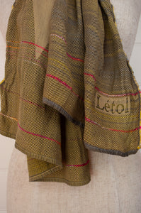 Létol scarf made in France from organic cotton, jacquard weave Désiré in Cachou, stripe design in shades of yellow olive, citrine and charcoal with highlights in brilliant pink.