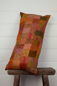 Vintage silk kantha bolster cushion, feather insert included, in shades of orange, mustard, rose and olive.