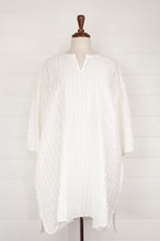 Load image into Gallery viewer, Maku Textiles Jessop white handloomed cotton seersucker easy fitting tunic dress, with three quarter sleeves, side seam pockets and side slits at hem.