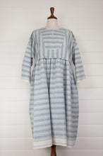 Load image into Gallery viewer, Maku Textiles Sefid dress in blue and white striped khadi cotton, one size loose fitting tunic dress with three quarter sleeves, front slit neck opening and gathered skirt and side pockets.