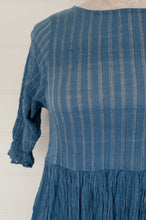 Load image into Gallery viewer, Maku Textiles Nir dress in handloomed khadi crushed crinkle cotton in indigo with a fine white stripe, three quarter sleeve, fitted bodice and gathered skirt, side pockets.