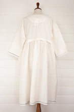 Load image into Gallery viewer, Maku Textiles Sefid dress in natural white cotton linen, one size loose fitting tunic dress with three quarter sleeves, front slit neck opening and gathered skirt and side pockets (back view).