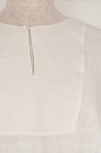 Load image into Gallery viewer, Maku Textiles Sefid dress in natural white cotton linen, one size loose fitting tunic dress with three quarter sleeves, front slit neck opening and gathered skirt and side pockets (detail).