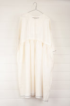 Load image into Gallery viewer, Maku Textiles Sefid dress in natural white cotton linen, one size loose fitting tunic dress with three quarter sleeves, front slit neck opening and gathered skirt and side pockets.