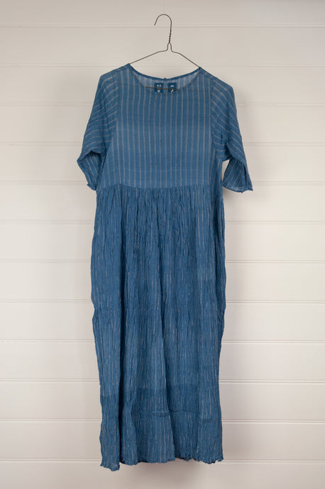 Maku Textiles Nir dress in handloomed khadi crushed crinkle cotton in indigo with a fine white stripe, three quarter sleeve, fitted bodice and gathered skirt, side pockets.