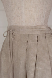 Dve Shiva skirt in natural check linen, one size with front pleats, elasticated back waist and tie, hand stitched details (waist detail).