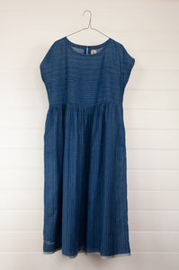 Dve Toshni dress indigo jamdani khadi cotton, easy fit cap sleeve bodice full skirt with pockets.