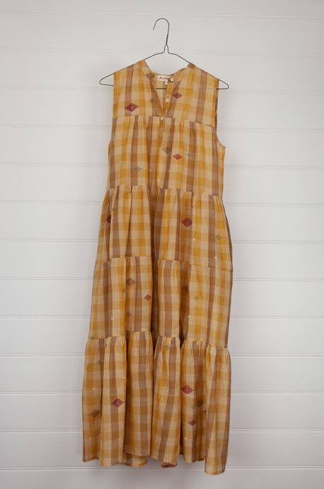 Artisav Claudia dress, mustard check jamdani, handwoven, sleeveless maxi length three tiered dress with button up bodice.