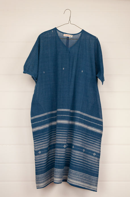 Artisav Naonica tunic dress is made from loose weave indigo cotton with handwoven white border detailing.  One size.