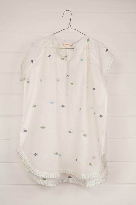 Artisav Mio top in white jamdani cotton, medallions in green and blue, button up cap sleeves with fine pleat trim.